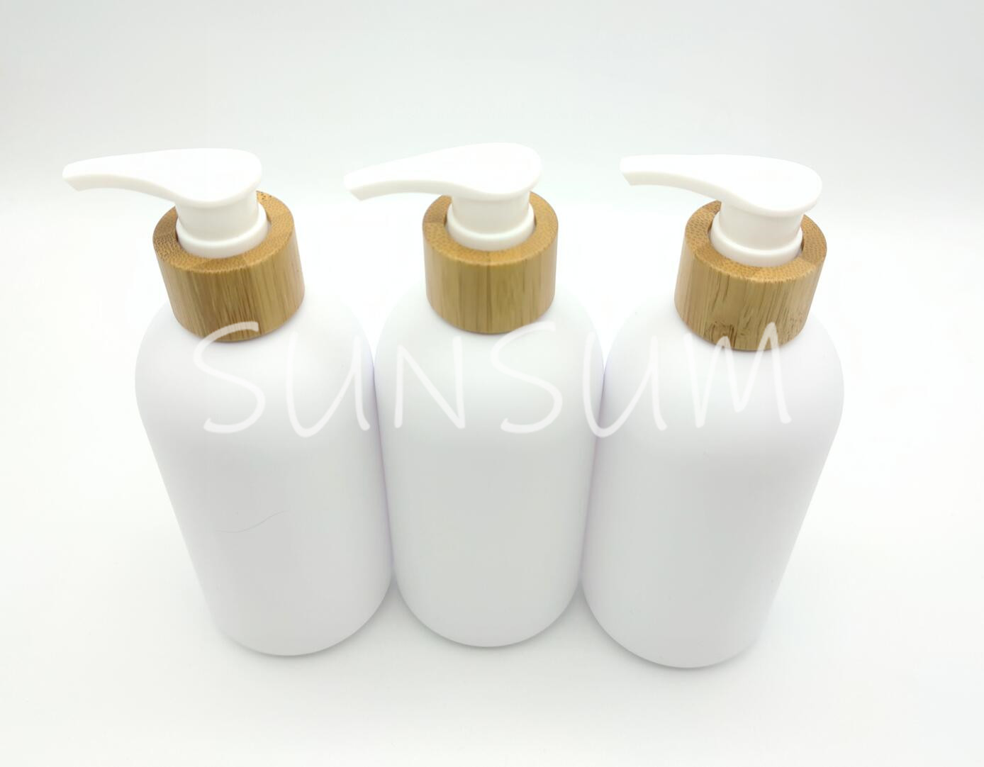 300ml white matte bottle with bamboo wood pump in stock